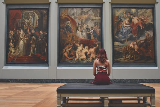 Girl looking at pictures in museum